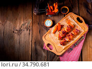 Spicy roasted meat with mushroom sauce in the oven. Стоковое фото, фотограф Zoonar.com/Darius Dzinnik / easy Fotostock / Фотобанк Лори