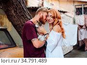 Beautiful couple posing outdoors at the camera. Стоковое фото, фотограф Zoonar.com/Oleksii Hrecheniuk / easy Fotostock / Фотобанк Лори