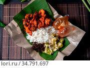 Nasi kukus ayam berempah, popular traditional Malay local food. Flat... Стоковое фото, фотограф Zoonar.com/szefei / easy Fotostock / Фотобанк Лори