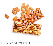 Sweet nut bars with honey and almonds isolated on white background. Стоковое фото, фотограф Zoonar.com/JIRI HERA / easy Fotostock / Фотобанк Лори