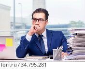 Workaholic businessman overworked with too much work in office. Стоковое фото, фотограф Elnur / Фотобанк Лори