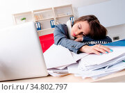 Beautiful female employee unhappy with excessive work. Стоковое фото, фотограф Zoonar.com/Elnur Amikishiyev / easy Fotostock / Фотобанк Лори