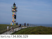 Tourism has grown a lot thanks to the Lighthouse of the Cantabrian... Редакционное фото, фотограф Joaquín Gómez / age Fotostock / Фотобанк Лори