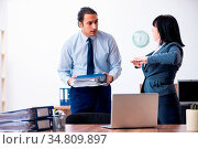 The two employees doing sport exercises in the office. Стоковое фото, фотограф Zoonar.com/Elnur Amikishiyev / easy Fotostock / Фотобанк Лори