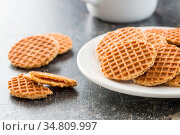 Sweet waffle biscuits on old kitchen table. Стоковое фото, фотограф Zoonar.com/JIRI HERA / easy Fotostock / Фотобанк Лори