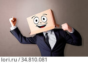 Young boy standing and gesturing with a cardboard box on his head. Стоковое фото, фотограф Zoonar.com/ranczandras / easy Fotostock / Фотобанк Лори