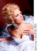Young and beautiful bride in luxury wedding dress. Стоковое фото, фотограф Zoonar.com/Sergejs Rahunoks / easy Fotostock / Фотобанк Лори