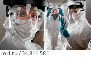 Team of Female and Male Doctors or Nurses Wearing Personal Protective... Стоковое фото, фотограф Zoonar.com/Andy Dean Photography / easy Fotostock / Фотобанк Лори