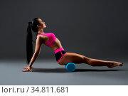 Beautiful fitness model in pink sportwear doing fitness profile shot. Стоковое фото, фотограф Zoonar.com/Andrey Guryanov / easy Fotostock / Фотобанк Лори