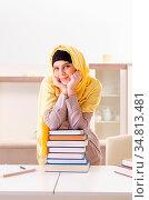 The female student in hijab preparing for exams. Стоковое фото, фотограф Zoonar.com/Elnur Amikishiyev / easy Fotostock / Фотобанк Лори