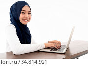 Asian young adult woman wearing hijab using laptop search and doing... Стоковое фото, фотограф Zoonar.com/Vichie81 / easy Fotostock / Фотобанк Лори