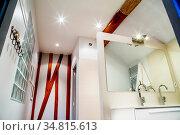 Interior of modern bathroom with faucets on white cabinet. Стоковое фото, фотограф Zoonar.com/Morad HEGUI / easy Fotostock / Фотобанк Лори