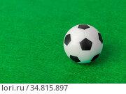 Soccer ball on football field - sport background. Стоковое фото, фотограф Zoonar.com/Nikolai Sorokin / easy Fotostock / Фотобанк Лори