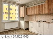 Brand new unfinished yet modern beige kitchen, minimalistic clean... Стоковое фото, фотограф Zoonar.com/Serghei Starus / easy Fotostock / Фотобанк Лори