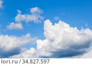 Blue sky with white cumulus clouds at daytime. Стоковое фото, фотограф EugeneSergeev / Фотобанк Лори