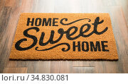 Home Sweet Home Welcome Mat On Wood Floor. Стоковое фото, фотограф Zoonar.com/Andy Dean Photography / easy Fotostock / Фотобанк Лори