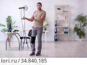 Young leg injured man with crutches. Стоковое фото, фотограф Elnur / Фотобанк Лори