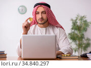 Young male arab employee working in the office. Стоковое фото, фотограф Elnur / Фотобанк Лори