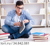 The young student studying with books. Стоковое фото, фотограф Elnur / Фотобанк Лори