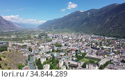 Picturesque aerial view of Martigny city in Rhone valley at foot of Swiss Alps. Стоковое видео, видеограф Яков Филимонов / Фотобанк Лори