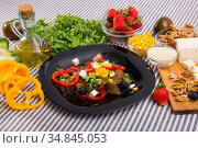 Plate with ready-made salad and its ingredients for recipe. Стоковое фото, фотограф Яков Филимонов / Фотобанк Лори