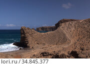 Gran Canaria, landscape of steep eroded north west coast between Galdar and Agaete municipalities, hike between villages Sardina del Norte and Puerto de Las Nieves. Стоковое фото, фотограф Tamara Kulikova / Фотобанк Лори