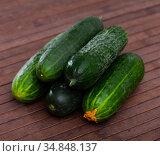 Many ripe juicy cucumbers on wooden surface. Стоковое фото, фотограф Яков Филимонов / Фотобанк Лори