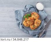 potato pancakes on gray tabletop, top view. Стоковое фото, фотограф Ольга Сергеева / Фотобанк Лори