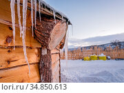 Icicles on the roof of wooden hut in northern Norway winter landscape... Стоковое фото, фотограф Zoonar.com/Pawel Opaska / easy Fotostock / Фотобанк Лори