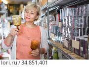 adult customer woman choosing wineglass. Стоковое фото, фотограф Яков Филимонов / Фотобанк Лори