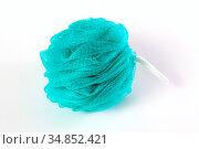 fluffy blue washcloth isolated on white background. Стоковое фото, фотограф Анна Гучек / Фотобанк Лори