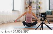 woman or sports blogger streaming online yoga. Стоковое видео, видеограф Syda Productions / Фотобанк Лори