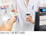 close up of pharmacist selling drug at pharmacy. Стоковое фото, фотограф Syda Productions / Фотобанк Лори