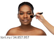 african woman and hand with make up brush. Стоковое фото, фотограф Syda Productions / Фотобанк Лори