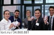 Business people throwing paper in the office 4k . Стоковое видео, агентство Wavebreak Media / Фотобанк Лори
