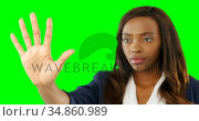 Woman pretending to use an invisible screen 4k. Стоковое видео, агентство Wavebreak Media / Фотобанк Лори