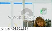 Woman using mobile phone while travelling in ferry 4k. Стоковое видео, агентство Wavebreak Media / Фотобанк Лори