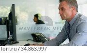 Businessman working on computer art desk 4k. Стоковое видео, агентство Wavebreak Media / Фотобанк Лори