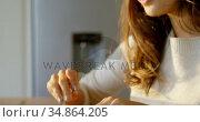 Beautiful woman having breakfast 4k. Стоковое видео, агентство Wavebreak Media / Фотобанк Лори