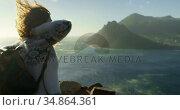 Woman standing with backpack near a sea 4k. Стоковое видео, агентство Wavebreak Media / Фотобанк Лори