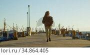 Woman walking on the dock 4k. Стоковое видео, агентство Wavebreak Media / Фотобанк Лори