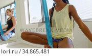 Group of women exercising on hammock swing 4k. Стоковое видео, агентство Wavebreak Media / Фотобанк Лори