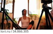 Young female video blogger recording video vlog while exercising 4k. Стоковое видео, агентство Wavebreak Media / Фотобанк Лори