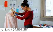 Fashion designer working on the dress makers model 4k. Стоковое видео, агентство Wavebreak Media / Фотобанк Лори