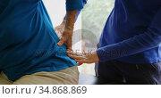 Physiotherapist examining senior woman back in clinic 4k. Стоковое видео, агентство Wavebreak Media / Фотобанк Лори