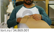 Man cutting cardboard paper 4k. Стоковое видео, агентство Wavebreak Media / Фотобанк Лори