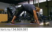 Senior woman stretching in fitness studio 4k. Стоковое видео, агентство Wavebreak Media / Фотобанк Лори