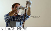 Photographer developing negative films 4k. Стоковое видео, агентство Wavebreak Media / Фотобанк Лори