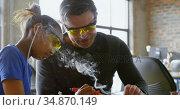 Father teaching her daughter about soldering iron 4k. Стоковое видео, агентство Wavebreak Media / Фотобанк Лори
