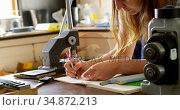 Jewelry designer drawing sketch on register 4k. Стоковое видео, агентство Wavebreak Media / Фотобанк Лори